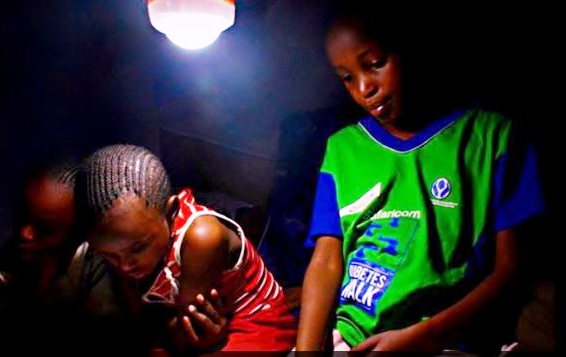 Solar lamps change the lives of students by giving them more time to read. Photo credit: Skynotch Africa